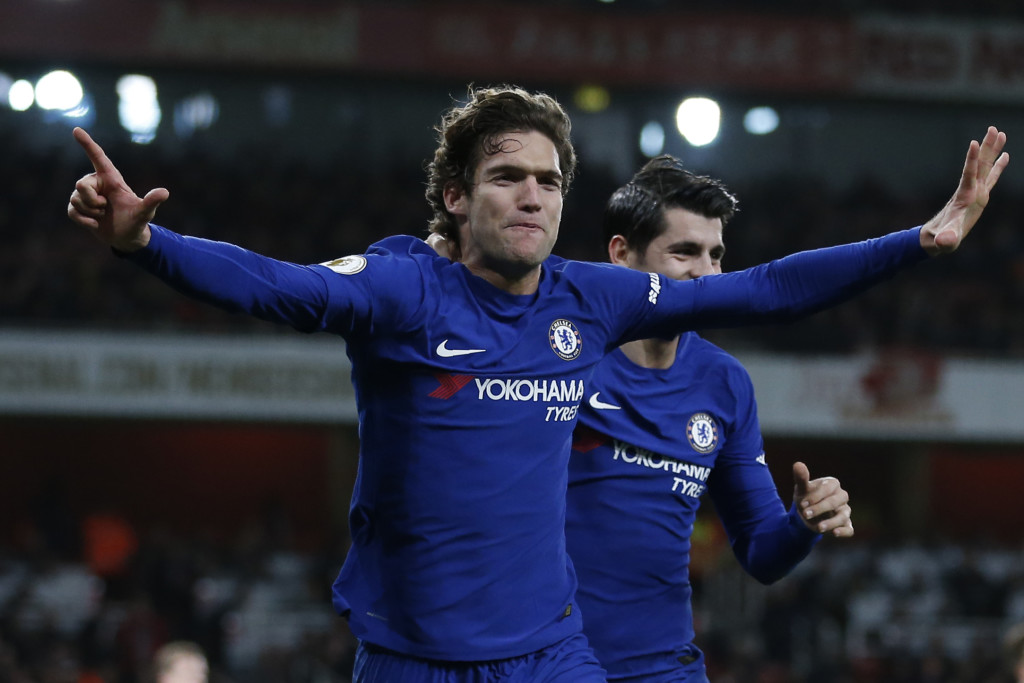 Chelsea's Spanish defender Marcos Alonso (L) celebrates after scoring with Chelsea's Spanish striker Alvaro Morata during the English Premier League football match between Arsenal and Chelsea at the Emirates Stadium in London on January 3, 2018. / AFP PHOTO / Ian KINGTON / RESTRICTED TO EDITORIAL USE. No use with unauthorized audio, video, data, fixture lists, club/league logos or 'live' services. Online in-match use limited to 75 images, no video emulation. No use in betting, games or single club/league/player publications. / (Photo credit should read IAN KINGTON/AFP/Getty Images)