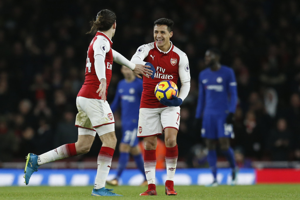 Arsenal's Spanish defender Hector Bellerin (L) celebrates after scoring their second goal with Arsenal's Chilean striker Alexis Sanchez during the English Premier League football match between Arsenal and Chelsea at the Emirates Stadium in London on January 3, 2018. / AFP PHOTO / Ian KINGTON / RESTRICTED TO EDITORIAL USE. No use with unauthorized audio, video, data, fixture lists, club/league logos or 'live' services. Online in-match use limited to 75 images, no video emulation. No use in betting, games or single club/league/player publications. / (Photo credit should read IAN KINGTON/AFP/Getty Images)