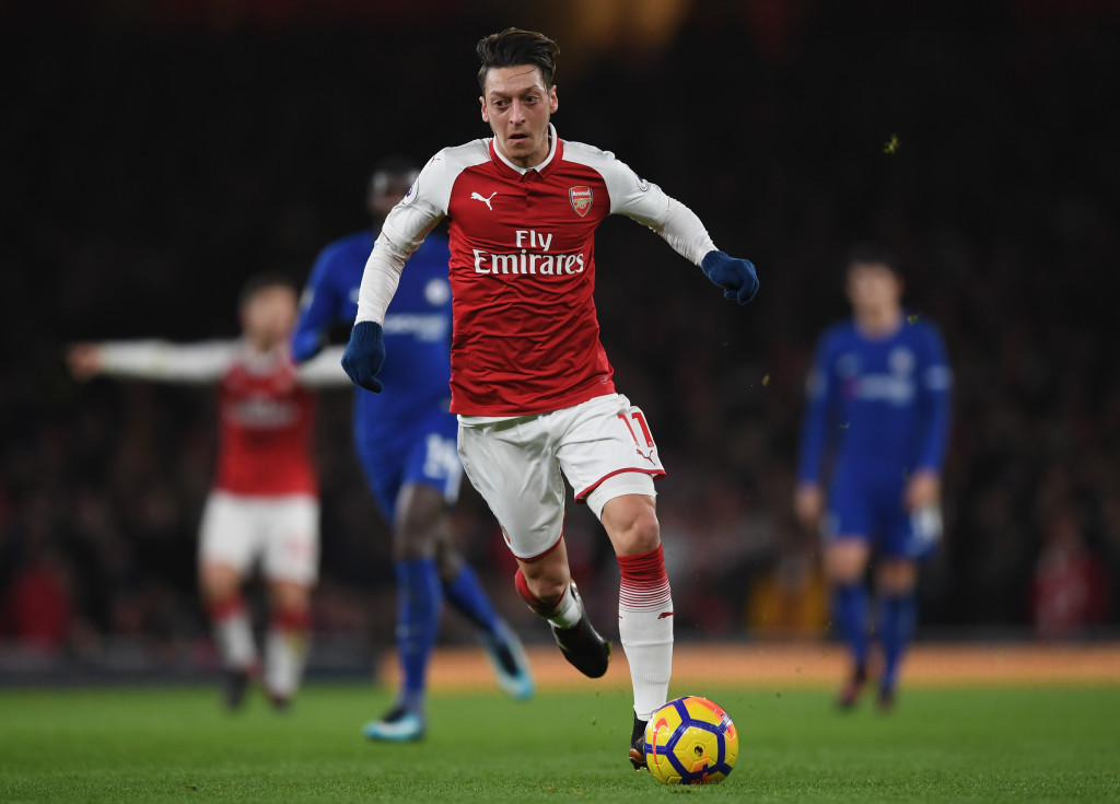 LONDON, ENGLAND - JANUARY 03: Mesut Ozil of Arsenal rubs with ball during the Premier League match between Arsenal and Chelsea at Emirates Stadium on January 3, 2018 in London, England. (Photo by Shaun Botterill/Getty Images)