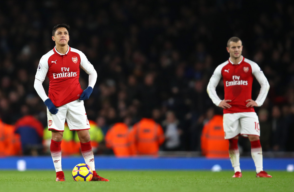 LONDON, ENGLAND - JANUARY 03: Alexis Sanchez of Arsenal and Jack Wilshere of Arsenal look on during the Premier League match between Arsenal and Chelsea at Emirates Stadium on January 3, 2018 in London, England. (Photo by Julian Finney/Getty Images)