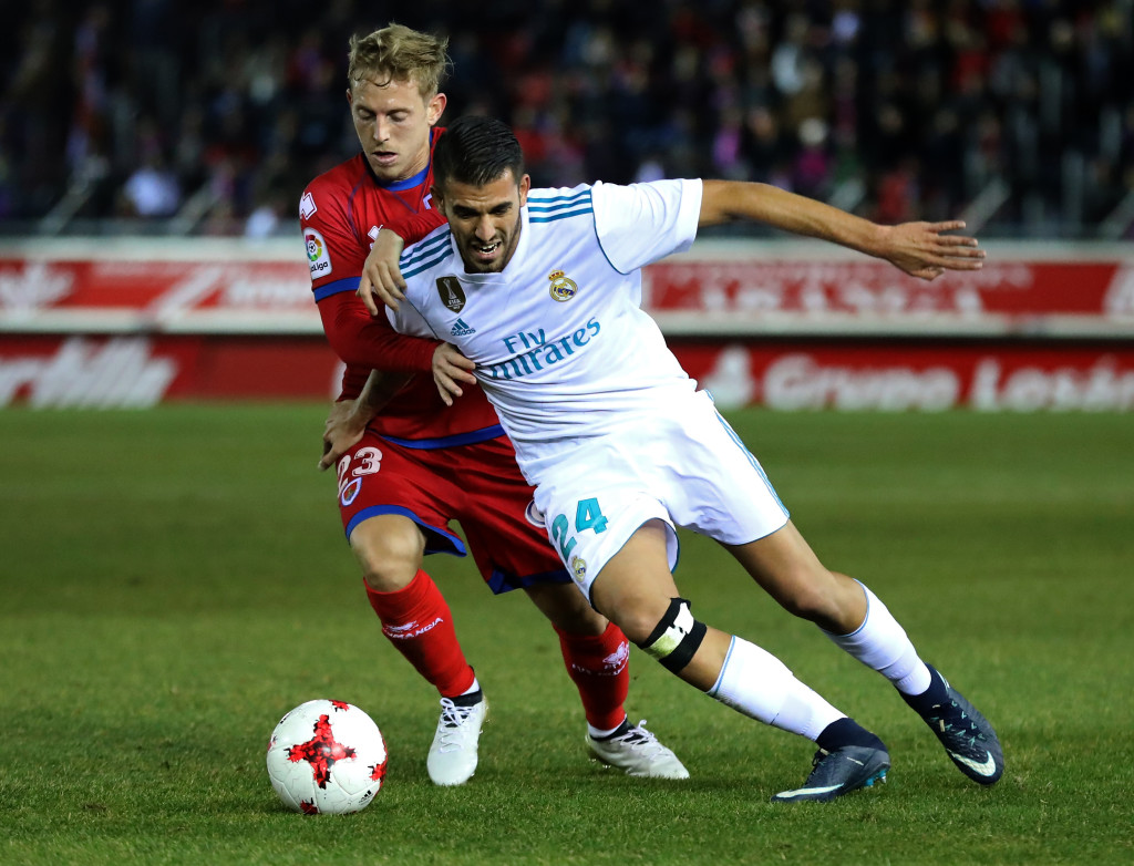 Numancia's midfielder Dani Nieto (L) vies with Real Madrid's Spanish midfielder Daniel Ceballos during the Spanish Copa del Rey (King's Cup) round of 16 first leg football match CD Numancia vs Real Madrid CF at Nuevo Estadio Los Pajaritos stadium in Soria on January 4, 2018. / AFP PHOTO / CESAR MANSO (Photo credit should read CESAR MANSO/AFP/Getty Images)