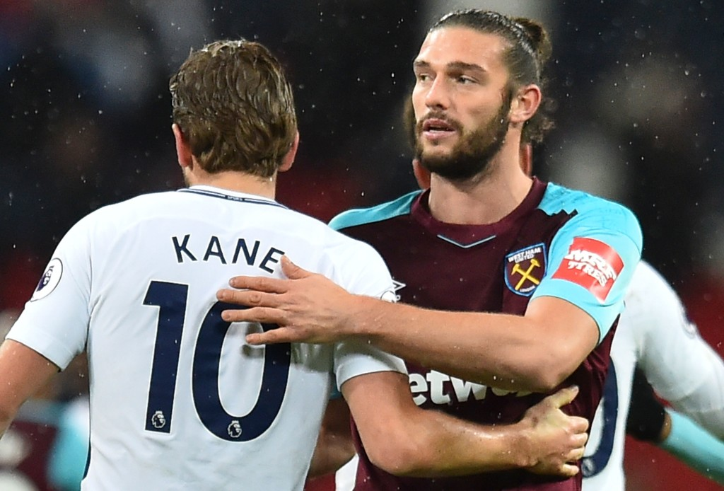 Tottenham Hotspur's English striker Harry Kane (L) greets West Ham United's English striker Andy Carroll (R) at the end of the English Premier League football match between Tottenham Hotspur and West Ham United at Wembley Stadium in London, on January 4, 2018. / AFP PHOTO / Glyn KIRK / RESTRICTED TO EDITORIAL USE. No use with unauthorized audio, video, data, fixture lists, club/league logos or 'live' services. Online in-match use limited to 75 images, no video emulation. No use in betting, games or single club/league/player publications.  /         (Photo credit should read GLYN KIRK/AFP/Getty Images)