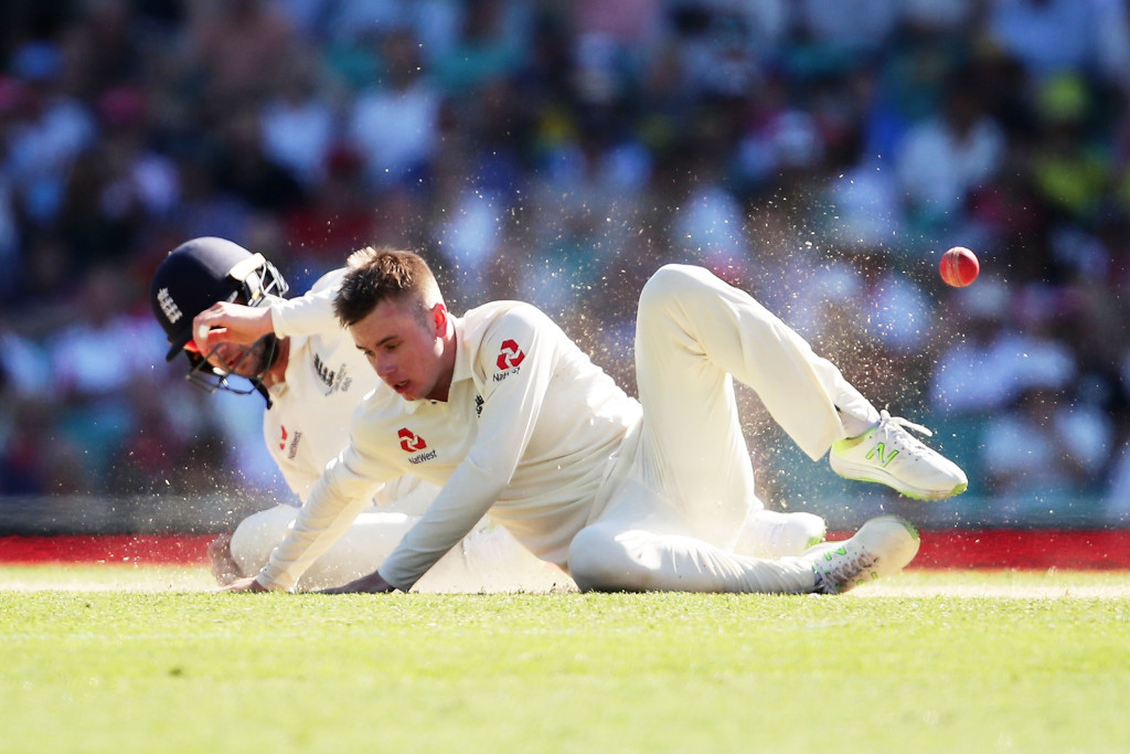 SYDNEY, AUSTRALIA - JANUARY 05: Mason Crane of England nearly collides with fielder Mark Stoneman of England as he attempts to catch his own delivery during day two of the Fifth Test match in the 2017/18 Ashes Series between Australia and England at Sydney Cricket Ground on January 5, 2018 in Sydney, Australia. (Photo by Matt King/Getty Images)