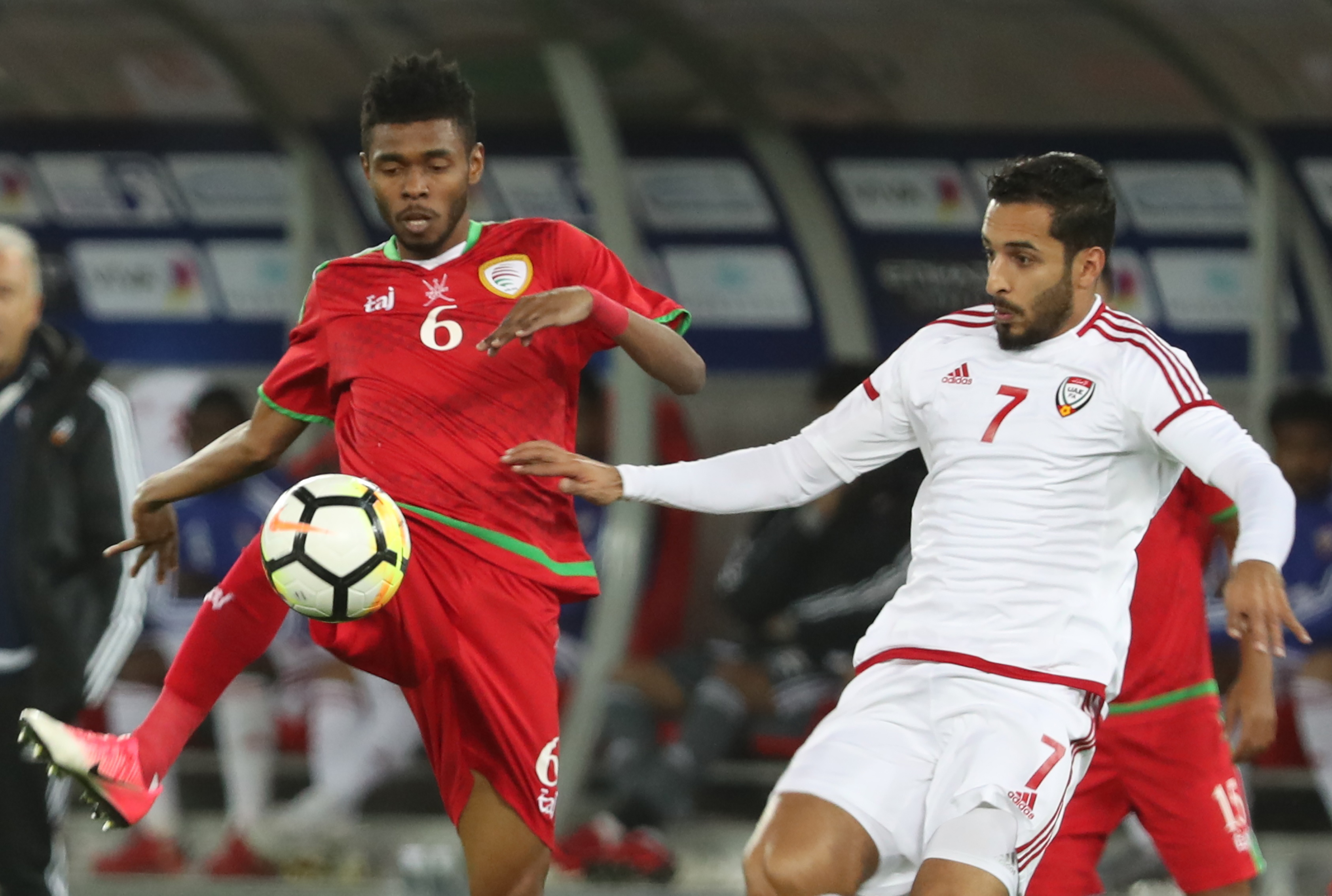 UAE striker Ali Mabkhout (r) struggled to unsettle the Oman defence.