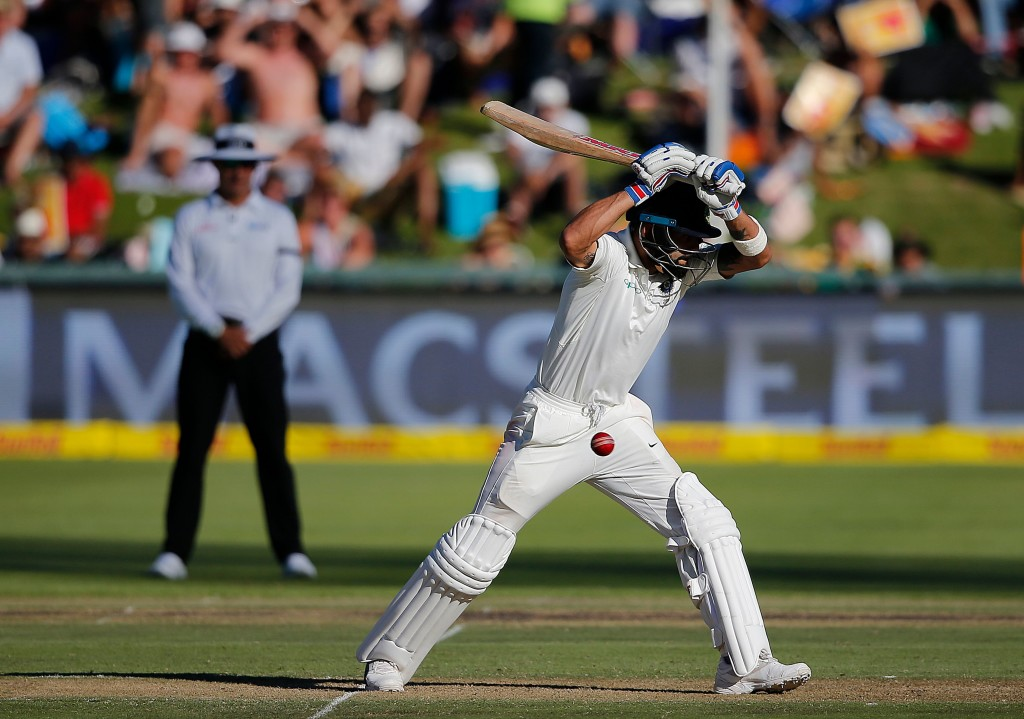 Indian batsman Virat Kohli lets a ball go during the first day of the first Test cricket match between South Africa and India at Newlands in Cape Town on January 5, 2018. / AFP PHOTO / MARCO LONGARI (Photo credit should read MARCO LONGARI/AFP/Getty Images)