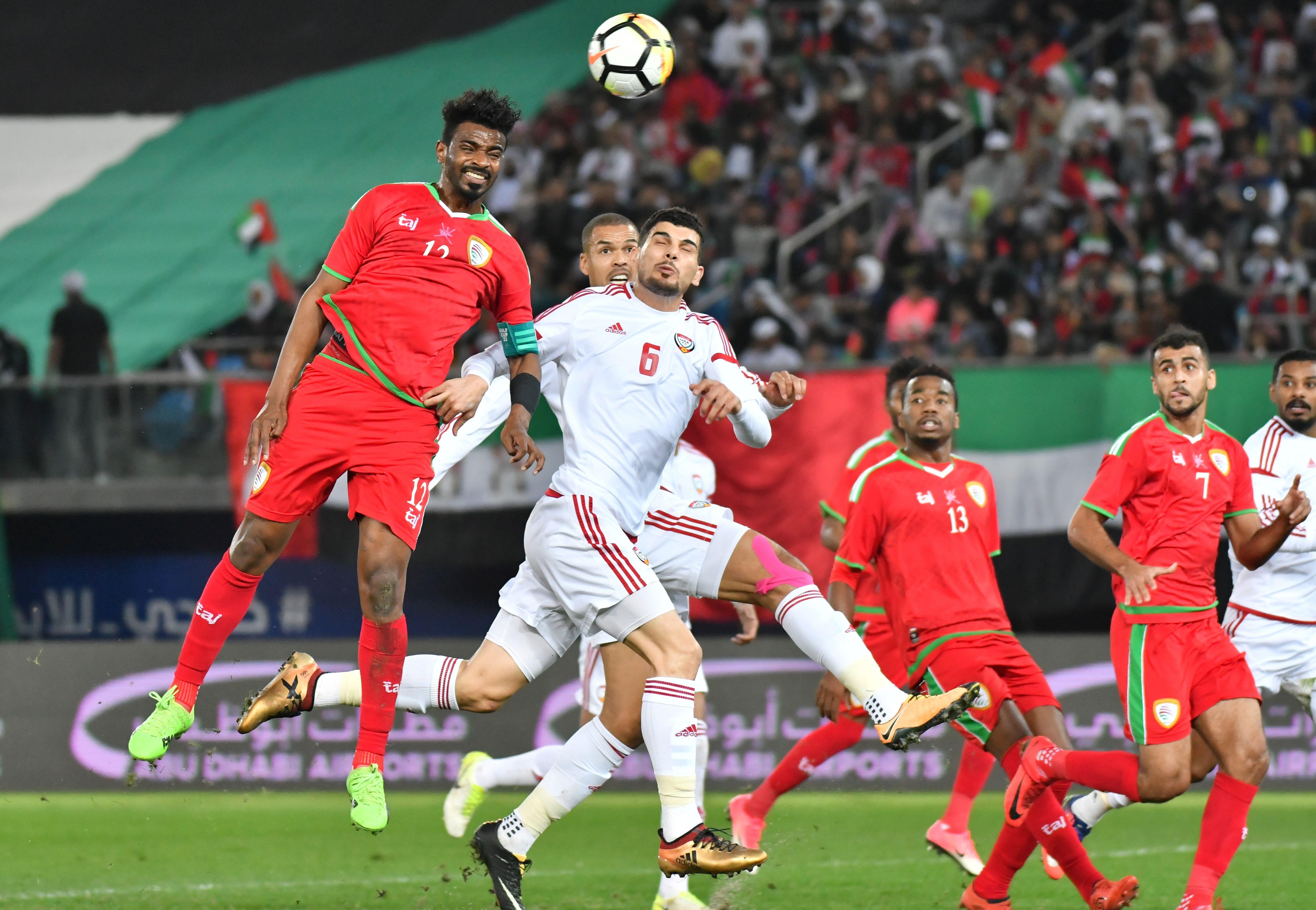 Ahmed Kano (No12) goes close for Oman.
