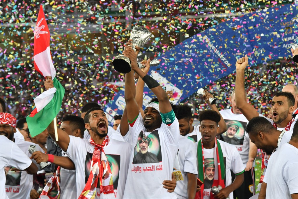 Oman's player Ahmed Mubarak holds the trophy next to his teammates after his team won the Gulf Cup of Nations 2017 final football match between Oman and the UAE at the Sheikh Jaber al-Ahmad Stadium in Kuwait City on January 5, 2018. / AFP PHOTO / GIUSEPPE CACACE (Photo credit should read GIUSEPPE CACACE/AFP/Getty Images)