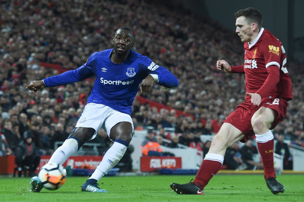 Everton's French striker Yannick Bolasie (L) plays the ball as Liverpool's Scottish defender Andrew Robertson (R) defends during the English FA Cup third round football match between Liverpool and Everton at Anfield in Liverpool, north west England on January 5, 2018. / AFP PHOTO / PAUL ELLIS / RESTRICTED TO EDITORIAL USE. No use with unauthorized audio, video, data, fixture lists, club/league logos or 'live' services. Online in-match use limited to 75 images, no video emulation. No use in betting, games or single club/league/player publications. / (Photo credit should read PAUL ELLIS/AFP/Getty Images)