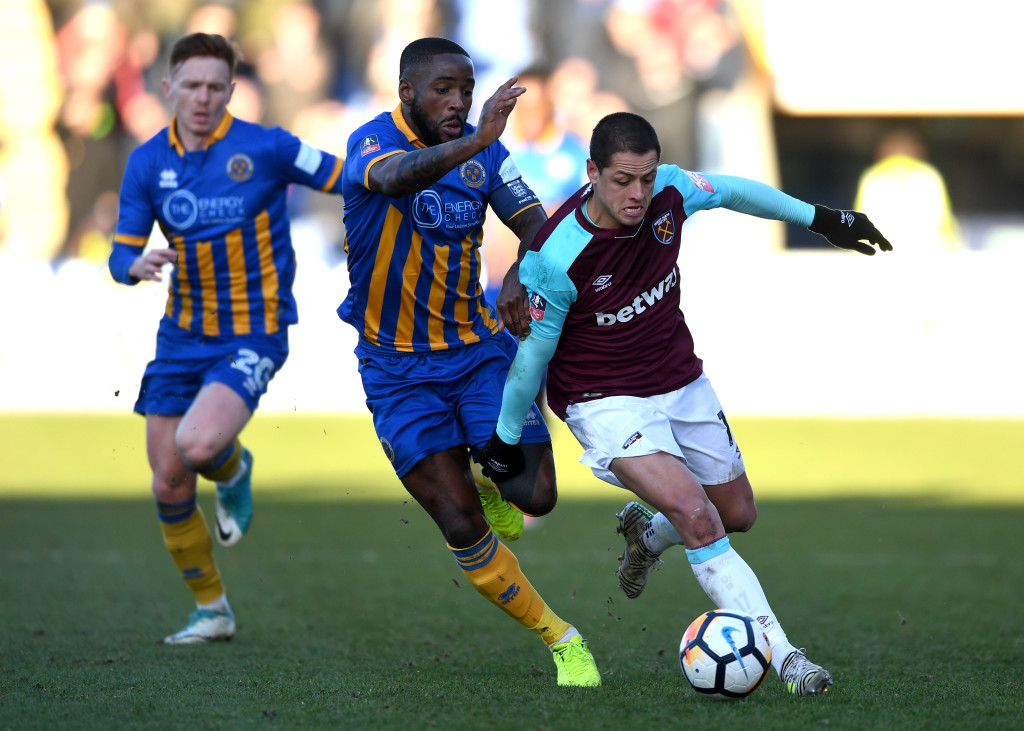 SHREWSBURY, ENGLAND - JANUARY 07: Abumere Ogogo of Shrewsbury Town and Javier Hernandez of West Ham United battle for the ball during The Emirates FA Cup Third Round match between Shrewsbury Town and West Ham United at Montgomery Waters Meadow on January 7, 2018 in Shrewsbury, England. (Photo by Gareth Copley/Getty Images)
