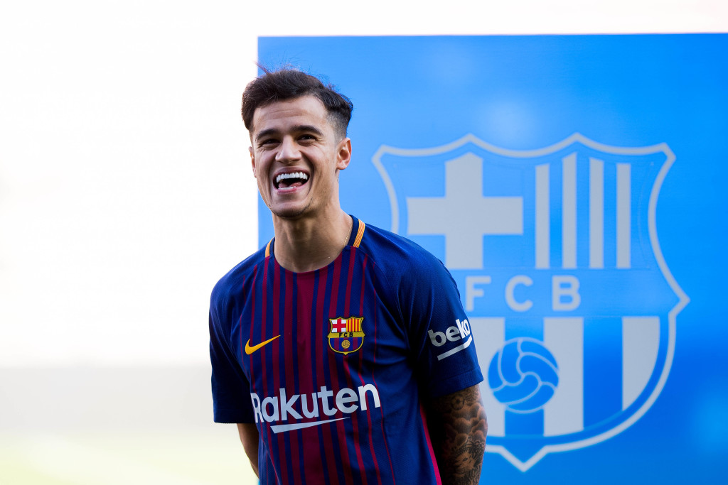 All smiles: Coutinho at his Barcelona unveiling