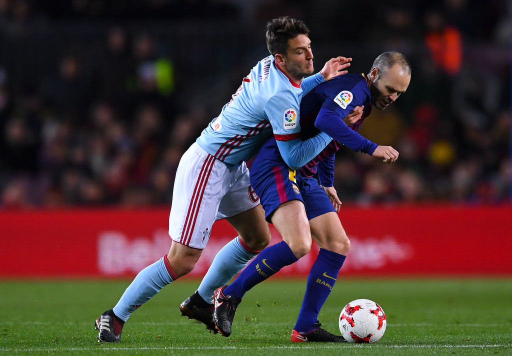 BARCELONA, SPAIN - JANUARY 11: Andres Iniesta of FC Barcelona competes for the ball with Nemanja Radoja of RC Celta de Vigo during the Copa del Rey round of 16 second leg match between FC Barcelona and Celta de Vigo at Camp Nou on January 11, 2018 in Barcelona, Spain. (Photo by David Ramos/Getty Images)