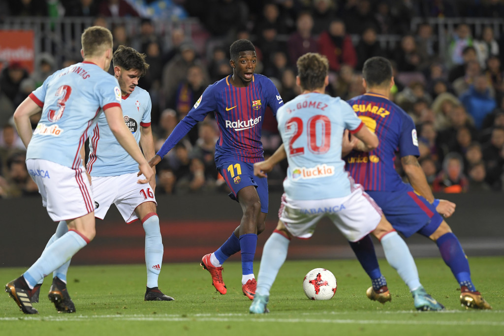Barcelona's French forward Ousmane Dembele (C) vies with Celta Vigo's Spanish defender Sergi Gomez during the Spanish Copa del Rey (King's Cup) round of 16 second leg football match FC Barcelona vs RC Celta de Vigo at the Camp Nou stadium in Barcelona on January 11, 2018. / AFP PHOTO / LLUIS GENE (Photo credit should read LLUIS GENE/AFP/Getty Images)