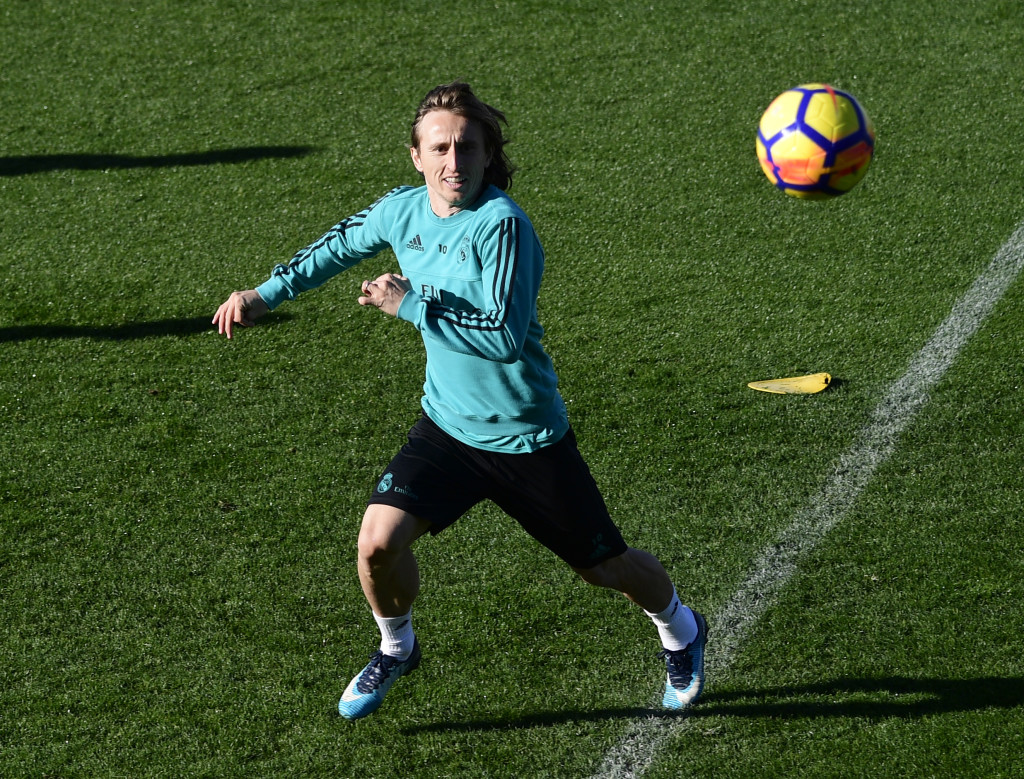 Real Madrid's Croatian midfielder Luka Modric attends a training session at Valdebebas sport city in Madrid on January 12, 2018 on the eve of a Spanish Liga football match against Villarreal. / AFP PHOTO / PIERRE-PHILIPPE MARCOU (Photo credit should read PIERRE-PHILIPPE MARCOU/AFP/Getty Images)