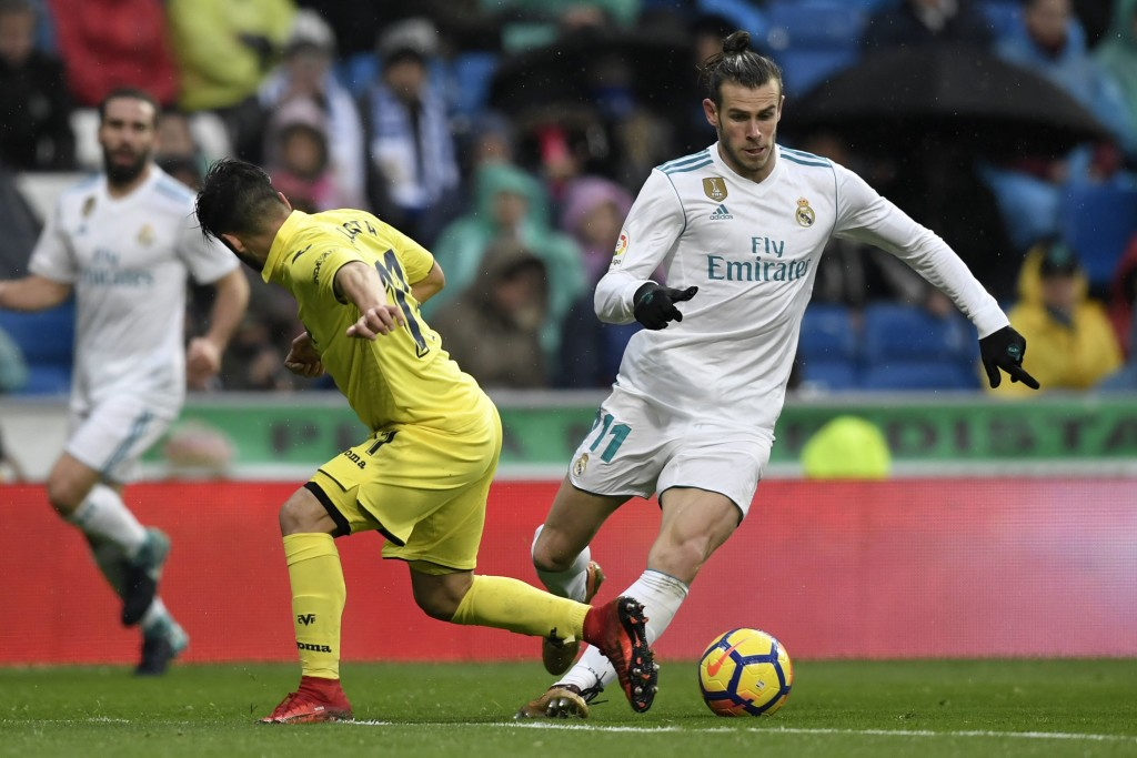 On the move: Gareth Bale jinks his way past Jaume Costa (L)