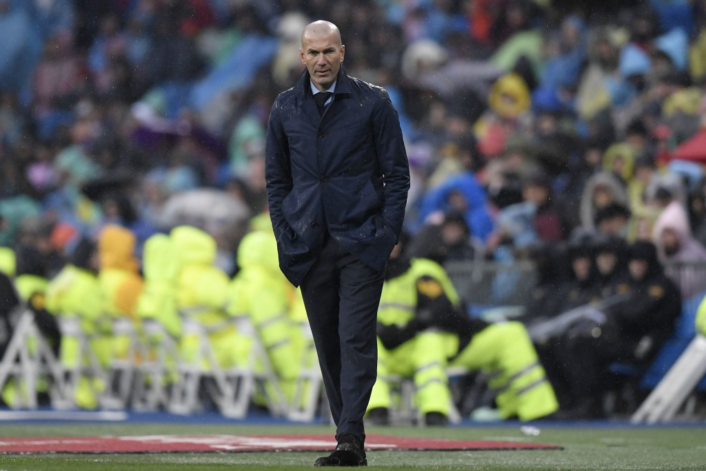 Real Madrid's French coach Zinedine Zidane reacts during the Spanish league football match between Real Madrid and Villarreal at the Santiago Bernabeu Stadium in Madrid on January 13, 2018. / AFP PHOTO / GABRIEL BOUYS (Photo credit should read GABRIEL BOUYS/AFP/Getty Images)