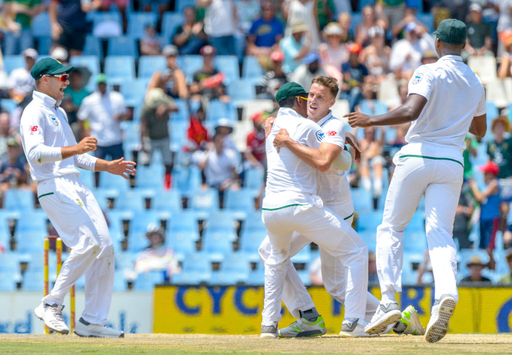 Morkel is mobbed by teammates after he pulled off an incredible catch.