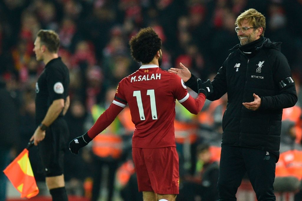 Jurgen Klopp (R) greets Mohamed Salah