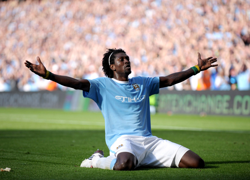 Emmanuel Adebayor celebrates scoring against Arsenal