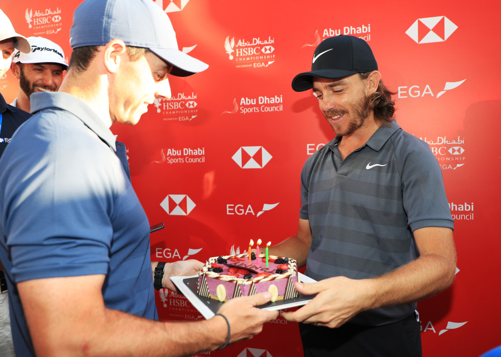 McIlroy and Fleetwood share a birthday joke in Abu Dhabi in 2018.