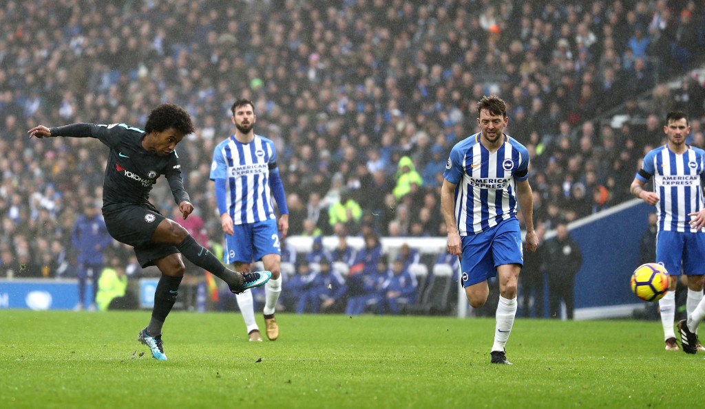 BRIGHTON, ENGLAND - JANUARY 20: Willian of Chelsea (L) scores their second goal during the Premier League match between Brighton and Hove Albion and Chelsea at Amex Stadium on January 20, 2018 in Brighton, England. (Photo by Bryn Lennon/Getty Images)
