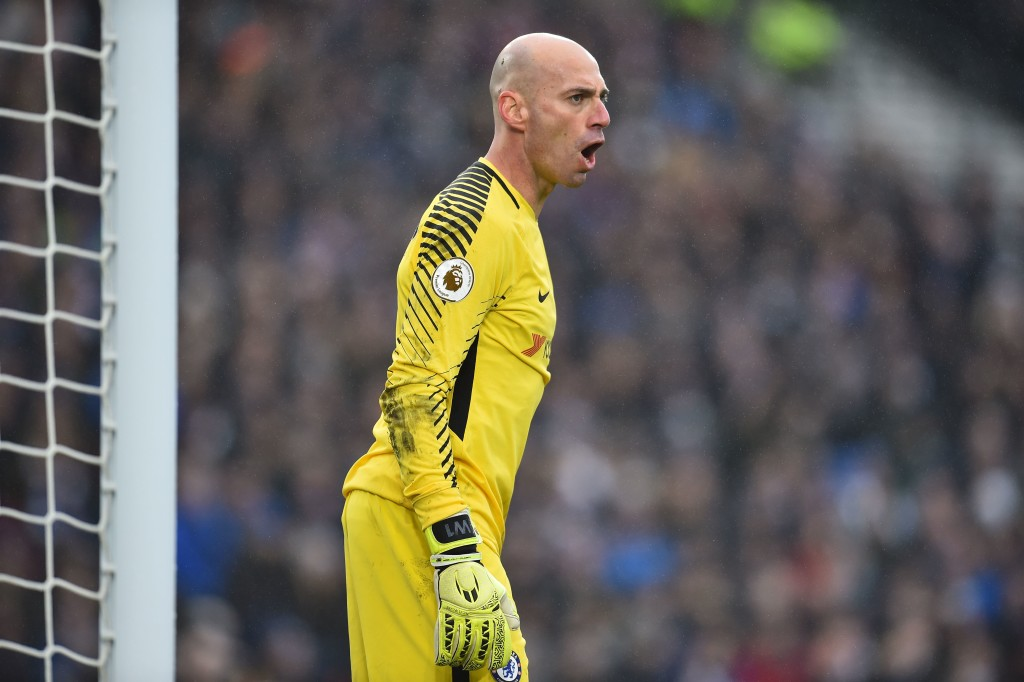 Chelsea's Argentinian goalkeeper Willy Caballero reacts during the English Premier League football match between Brighton and Hove Albion and Chelsea at the American Express Community Stadium in Brighton, southern England on January 20, 2018. / AFP PHOTO / Glyn KIRK / RESTRICTED TO EDITORIAL USE. No use with unauthorized audio, video, data, fixture lists, club/league logos or 'live' services. Online in-match use limited to 75 images, no video emulation. No use in betting, games or single club/league/player publications. / (Photo credit should read GLYN KIRK/AFP/Getty Images)