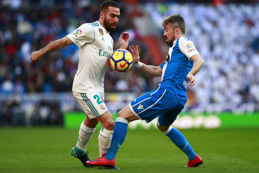 MADRID, SPAIN - JANUARY 21: Daniel Carvajal (L) of Real Madrid CF competes for the ball with Luisinho Correia (R) Deportivo La Coruna during the La Liga match between Real Madrid CF and Deportivo La Coruna at Estadio Santiago Bernabeu on January 21, 2018 in Madrid, Spain. (Photo by Gonzalo Arroyo Moreno/Getty Images)