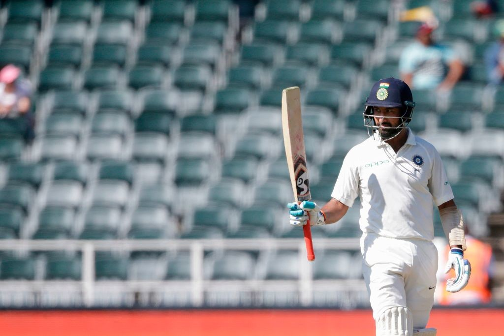 Pujara brought up his first fifty in 13 innings outside the Asian continent.