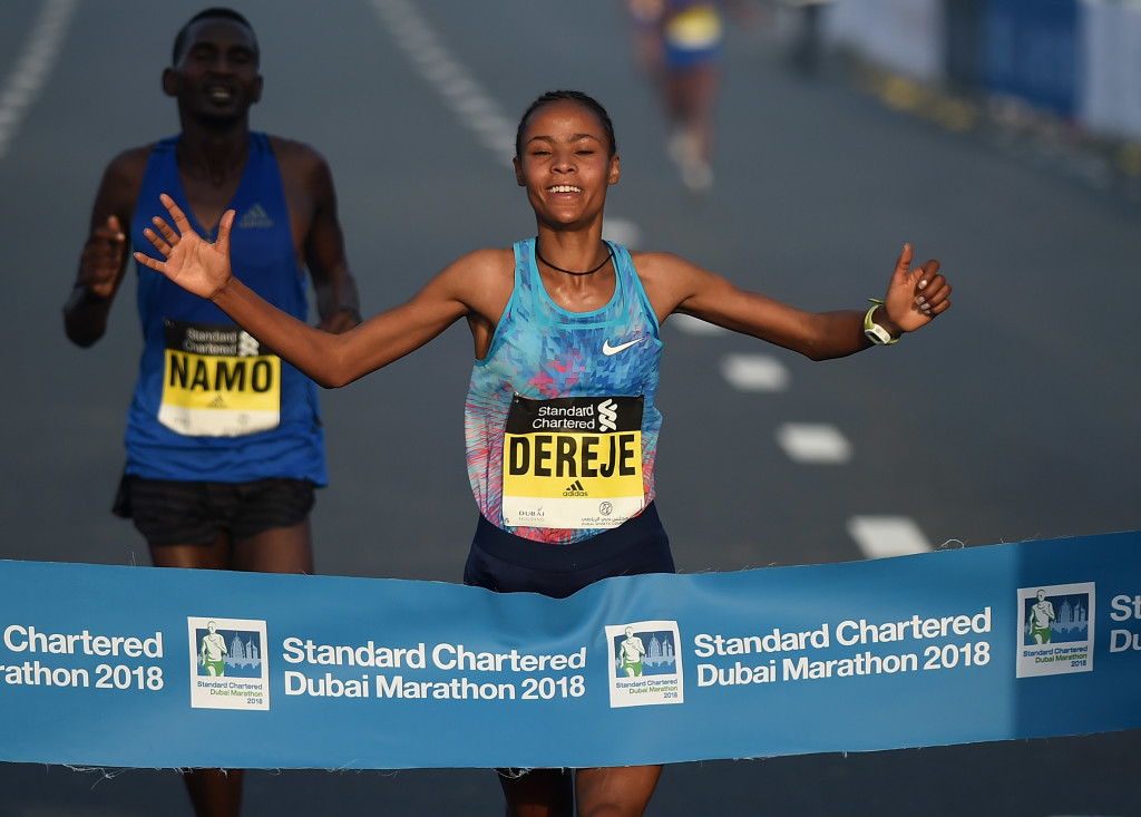 DUBAI, UNITED ARAB EMIRATES - JANUARY 26: Roza Dereje Bekele of Ethiopia crosses the finish line to win the Standard Chartered Dubai Marathon on January 26, 2018 in Dubai, United Arab Emirates. (Photo by Tom Dulat/Getty Images)