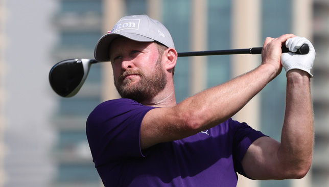 McIlroy hot in late stages of second round to take Dubai lead