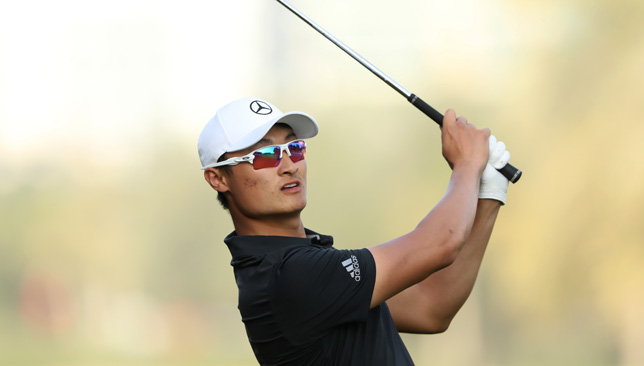 Chinese star Li Haotong one clear of McIlroy in Dubai