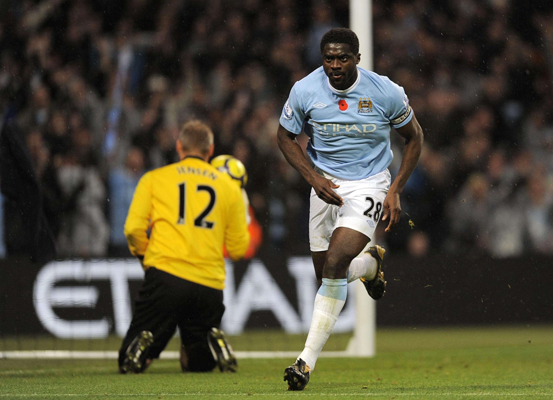Kolo Toure wheels away to celebrate scoring for Manchester City