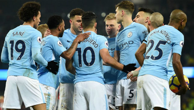 Manchester City players celebrate a goal.