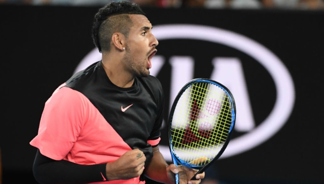 Nick Kyrgios chats with Hollywood star Will Smith during victory over Tsonga