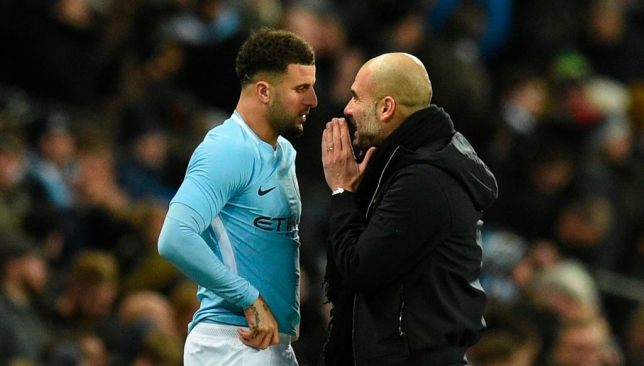 Kyle Walker (l) with Pep Guardiola (r)