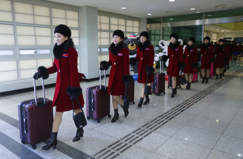 North Korea's charm offensive includes a sizable cheering squad.