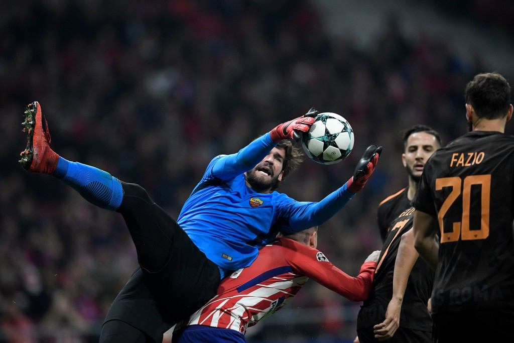 Up in the air: Alisson could be a Real Madrid player in the summer.