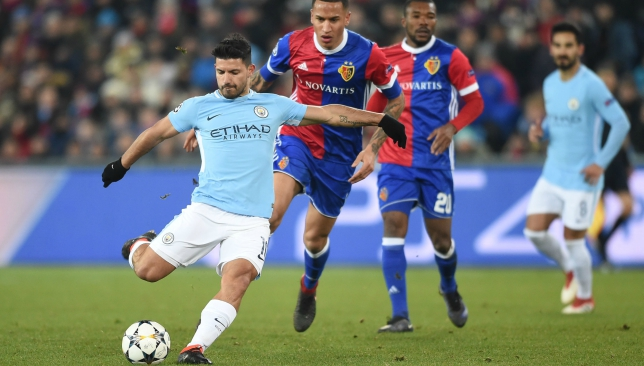 Sergio Aguero (l) scores a thumping third for Manchester City at Basel.