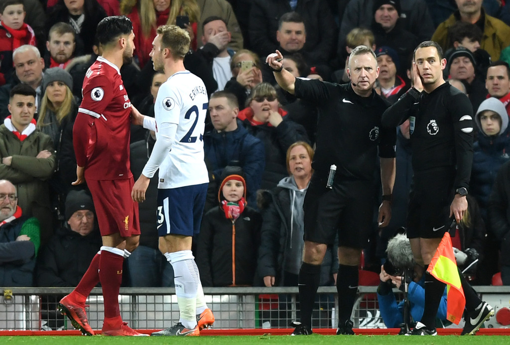 LIVERPOOL, ENGLAND - FEBRUARY 04: Refree Jonathan Moss consults with his assistant referee over a penalty decision during the Premier League match between Liverpool and Tottenham Hotspur at Anfield on February 4, 2018 in Liverpool, England. (Photo by Michael Regan/Getty Images)