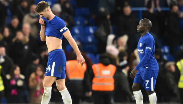 Chelsea players walk off the field after loss to Bournemouth.