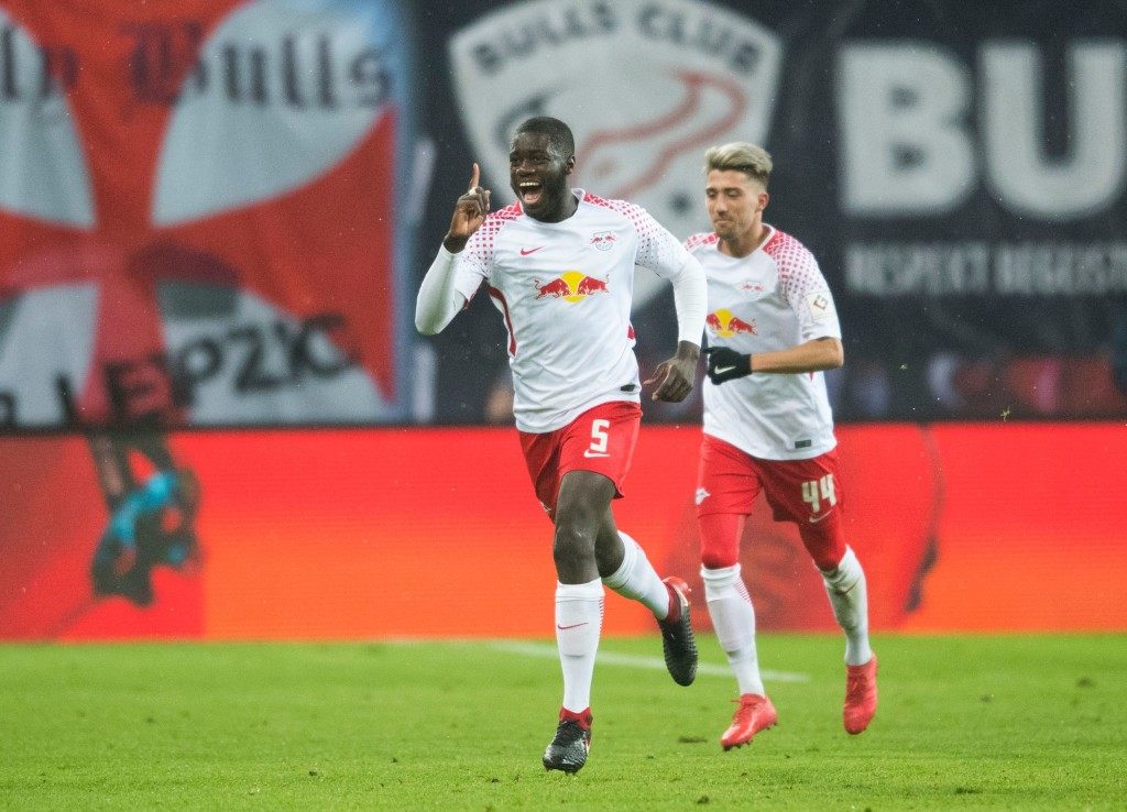 Leipzig´s French defender Dayot Upamecano celebrates scoring during the German first division Bundesliga football match between RB Leipzig and FC Augsburg in Leipzig, eastern Germany on February 9, 2018. / AFP PHOTO / ROBERT MICHAEL (Photo credit should read ROBERT MICHAEL/AFP/Getty Images)