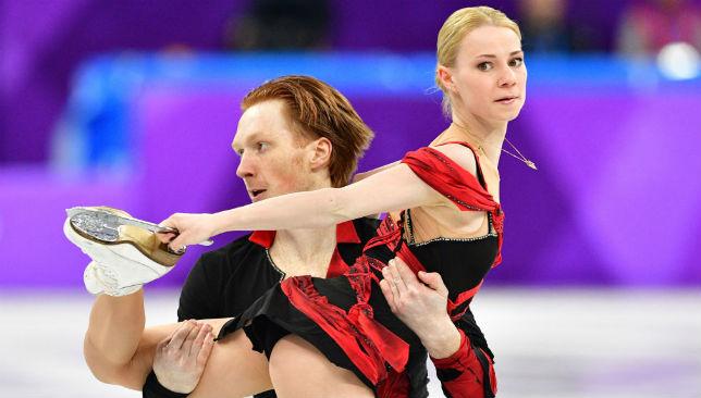 Evgenia Tarasova (R) and Russia's Vladimir Morozov