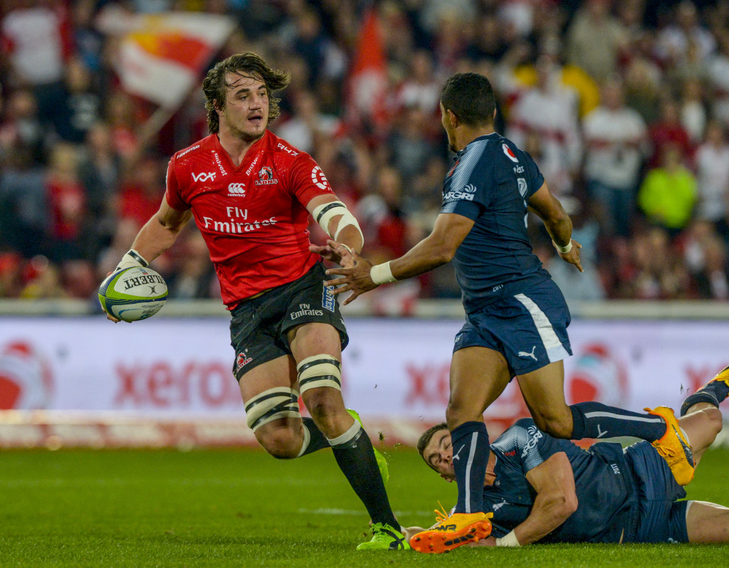 JOHANNESBURG, SOUTH AFRICA - MAY 20: Franco Mostert of the Lions challenged by Jesse Kriel of the Blue Bulls and Rudy Paige of the Blue Bulls during the Super Rugby match between Emirates Lions and Vodacom Bulls at Emirates Airline Park on May 20, 2017 in Johannesburg, South Africa. (Photo by Sydney Seshibedi/Gallo Images/Getty Images)