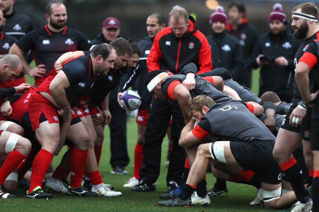 Referee Wayne Barnes oversees a scrummaging session between the England and Georgia packs