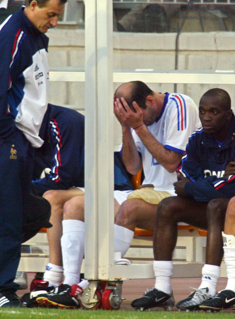 SUWON, REPUBLIC OF KOREA: French national soccer player Zinedine Zidane holds his head after an injury at the left thigh, 26 May 2002, during the friendly match Korea-France in Suwon, South Korea. AFP PHOTO/ PATRICK HERTZOG (Photo credit should read PATRICK HERTZOG/AFP/Getty Images)