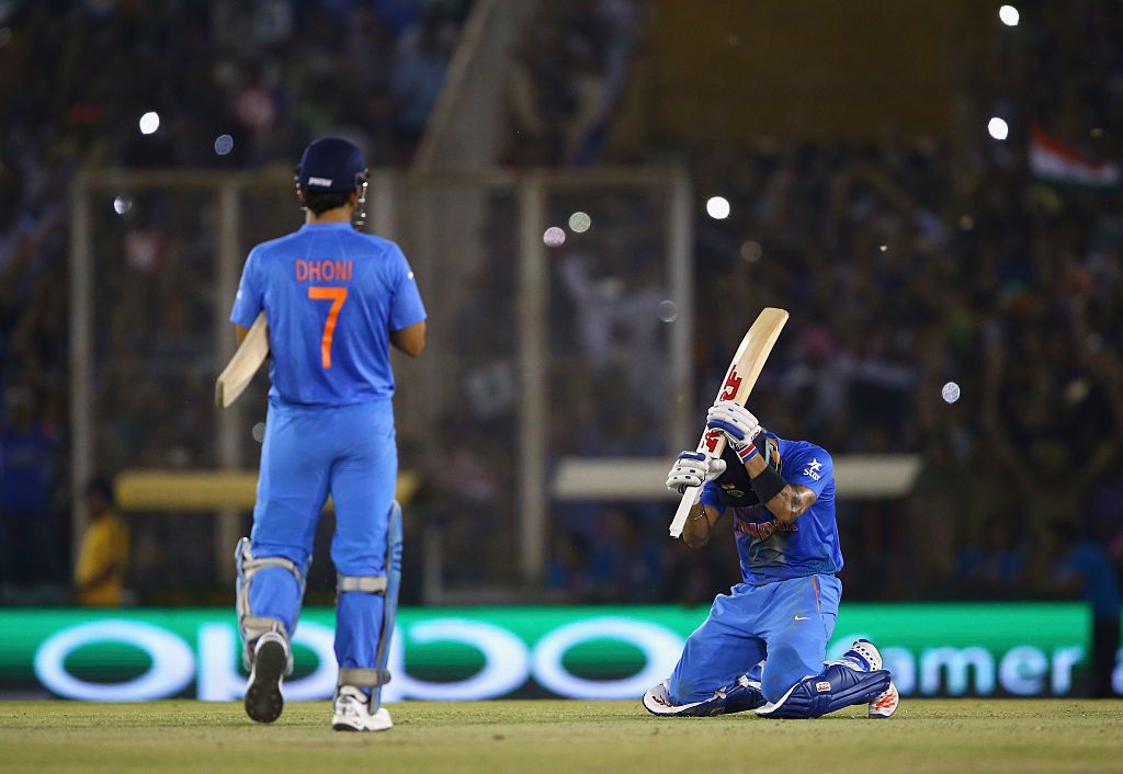 Kohli sinks to his knees as India score the winning runs.