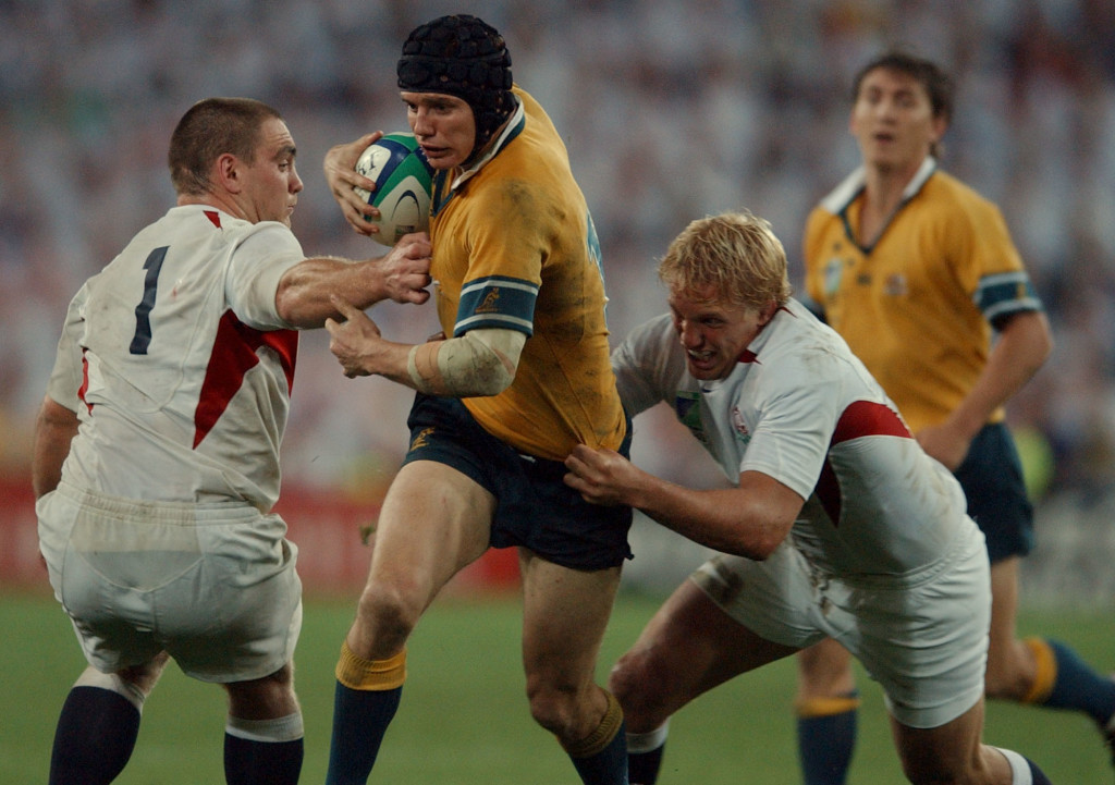 SYDNEY, AUSTRALIA - NOVEMBER 23: Australia's Stephen Larkham is tackled by England's Lewis Moody in the 2003 Rugby World Cup Final played at the Telstra Stadium,Saturday.England won in extra time 2017. (Photo by Phil Walter/Getty Images)