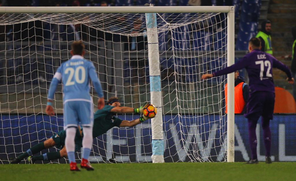 Lazio goalkeeper Federico Marchetti saves the penalty of Fiorentina's Josip Ilicic.
