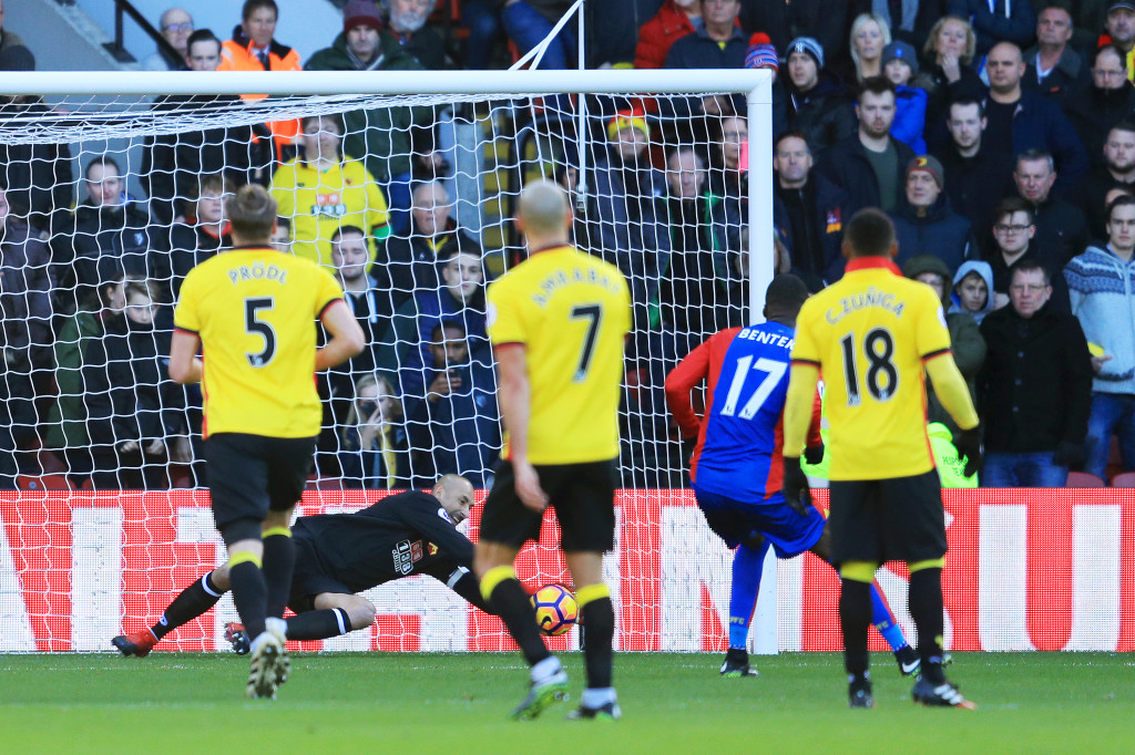 Heurelho Gomes of Watford saves a penalty from Christian Benteke.