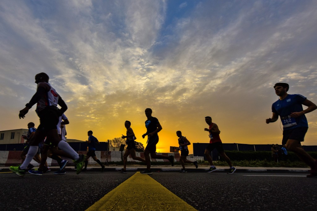 TOPSHOT - Runners compete in the Dubai Marathon in the Gulf emirate on January 20, 2017. Middle distance legend Kenenisa Bekele, who was aiming to add the marathon world record to his 5,000 metres and 10,000 metres records, limped out of the Dubai event after a fall. / AFP / STRINGER (Photo credit should read STRINGER/AFP/Getty Images)