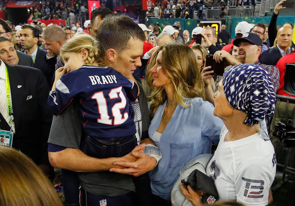 HOUSTON, TX - FEBRUARY 05: Tom Brady #12 of the New England Patriots celebrates with wife Gisele Bundchen and daughter Vivian Brady after defeating the Atlanta Falcons during Super Bowl 51 at NRG Stadium on February 5, 2017 in Houston, Texas. The Patriots defeated the Falcons 34-28. (Photo by Kevin C. Cox/Getty Images)